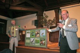 Connecticut Audubon Society&#039;s new chairman, Ralph Wood, right, and Communications Director Tom Andersen, unveil a framed montage of the covers of our seven Connecticut State of the Birds awards, which was presented to outgoing Chairman Stephen Oresman as a thank you for his years of leadership.