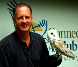 Alex Brash, Connecticut Audubon Society's new president, with one of the Barn Owls the organization uses for education programs. Photo copyright Connecticut Audubon Society