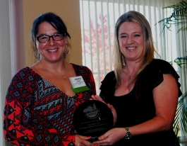 Connecticut Audubon's Director of Education Michelle Eckman, left, receives the Maria Pirie Environmental Education Program Award from NEEEA Board Member Sarah Whilby.