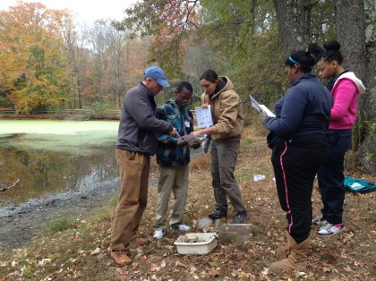 CAS President Alex Brash (in the blue hat) and Teacher-Naturalist Cat Holmberg (in the brown jacket), work with 8th graders from Bridgeport's Curiale School. Photo copyright Connecticut Audubon Society
