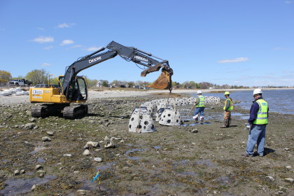 A front-end loader moves a reef ball into place. Photo by Mark Beekey, Associate Professor, Sacred Heart University