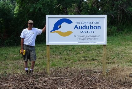 Sanctuary Manager John Laiacone after putting up the new Smith Richardson sign. Photo by Stephanie Galea/Connecticut Audubon Society