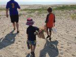 CC walking to beach with seine net